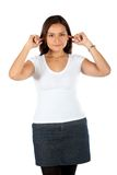 Woman plugging her ears Royalty Free Stock Photo