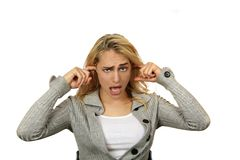 Woman Plugging Her Ears Stock Photos