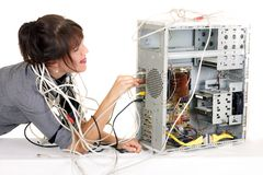 Woman pluging cable Stock Image