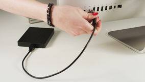 A Woman Plugs External Hard Disc Drive to a Computer. Cable plugging. Shot on RED Epic stock footage