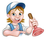 Woman Plumber Holding Plunger. A handyman plumber cartoon character holding a plunger and pointing Royalty Free Stock Image
