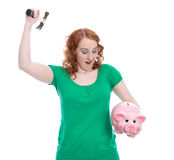 Woman plunders her piggy bank isolated on white royalty free stock photography