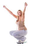 Woman plus size on scale celebrating weightloss. Woman plus size large happy girl with weight scale celebrating weightloss progress after diet, she lost some Royalty Free Stock Image