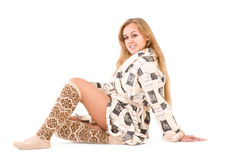 Woman in a plush bathrobe Stock Images