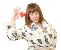 Woman in a plush bathrobe with red heart Stock Image