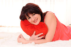 Woman with plush heart Royalty Free Stock Photography