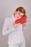 Woman with plush red heart Stock Images