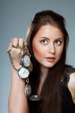 Woman with pocket clocks Stock Image