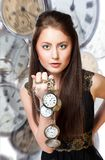 Woman with pocket watches Stock Photography
