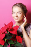 Woman with poinsettia Stock Images