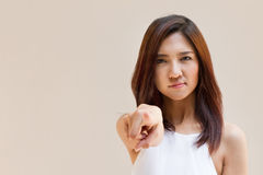 Woman point finger at you, negative or angry mood. With text space and plain background stock photography