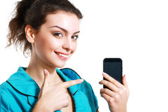 Woman point to cell phone Royalty Free Stock Images