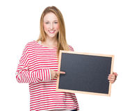 Woman point to chalkboard Stock Photos