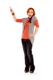 Woman Pointing. A red headed woman pointing on a white background royalty free stock photography