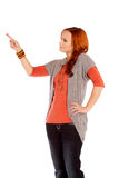 Woman Pointing. A serious woman pointing on a white background stock photography