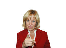 Woman Pointing. Blonde woman in red business suit pointing fingure royalty free stock photography