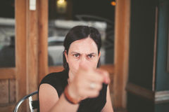 Woman pointing with angry expression Stock Images