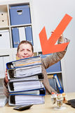 Woman pointing with arrow to files Stock Images