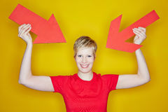Woman pointing with arrows to herself stock photo