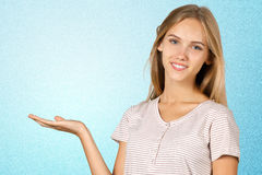 Woman pointing aside Royalty Free Stock Image