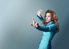 Woman Pointing At Copy Space. Focus On Hand. Royalty Free Stock Images
