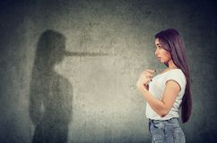Free Woman Pointing At Herself Looking At A Shadow With Long Nose Of A Liar Stock Image - 156643131