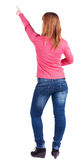 Woman pointing. Back view Royalty Free Stock Photos
