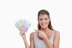 Woman pointing at bank notes Stock Photos