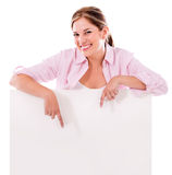 Woman pointing a banner ad Royalty Free Stock Images
