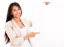 Woman pointing at a banner Stock Photography