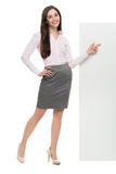 Woman pointing at blank banner Royalty Free Stock Photography
