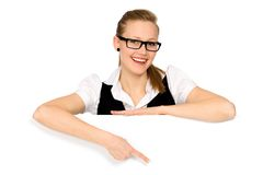 Woman pointing at a blank board Royalty Free Stock Photos