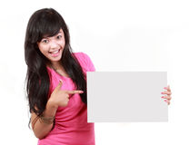 Woman pointing at a blank board Royalty Free Stock Photography