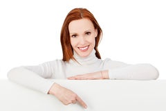 Woman pointing at a blank board Stock Photography