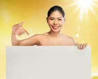Woman pointing blank board Stock Images