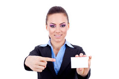 Woman pointing at blank card Stock Photography