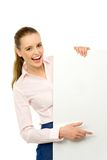 Woman pointing at blank poster Stock Images
