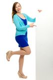 Woman pointing at blank poster Royalty Free Stock Photography