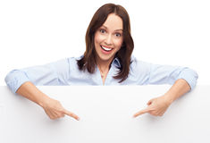 Woman pointing at blank poster Royalty Free Stock Image