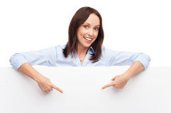 Woman pointing at blank poster Royalty Free Stock Photo