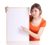 Woman pointing on blank sign, billboard Stock Image