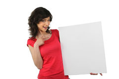 Woman pointing at a board Stock Photo