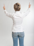 Woman pointing with both hands Royalty Free Stock Photography