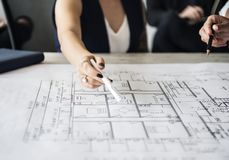 Woman pointing at building plan Royalty Free Stock Image