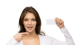 Woman pointing at business card Stock Image