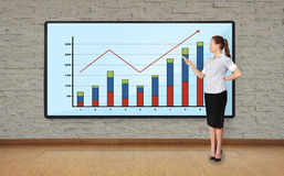 Woman pointing at chart Stock Photo