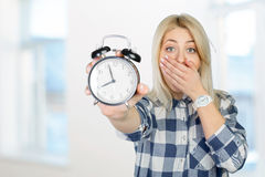 Woman pointing on clock Royalty Free Stock Image