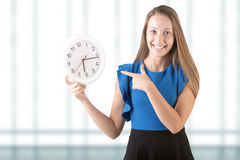 Woman Pointing at Clock Royalty Free Stock Photography