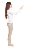 Woman pointing at copy space Royalty Free Stock Photography