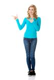Woman pointing on copy space. Royalty Free Stock Images
